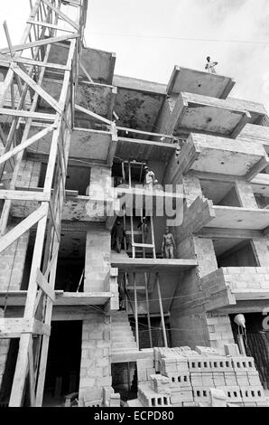 Following the Socialist idea, working brigades of young architects, builders and future inhabitans, build the new - Stock Photo