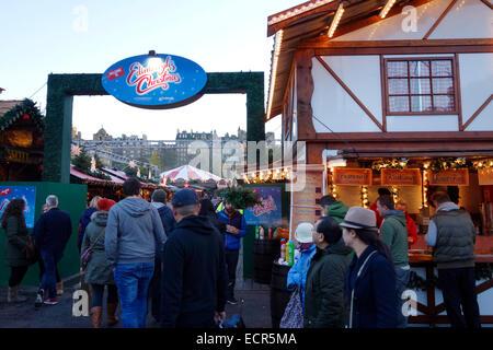People entering the Edinburgh Christmas Market on Princes Street - Stock Photo