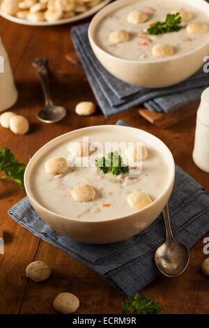 Homemade New England Clam Chowder with Crackers - Stock Photo
