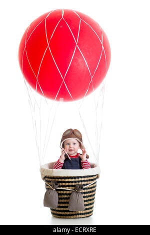 child boy on hot air balloon isolated on white - Stock Photo