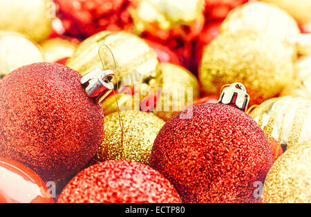 Red and golden christmas tree balls together - vintage tinted - Stock Photo