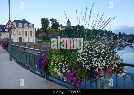 Amenity bedding display in planters on a bridge over the Mayenne in Chateau Gontier, France - Stock Photo