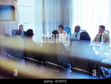 Group of smiling business people attending meeting in conference room - Stock Photo