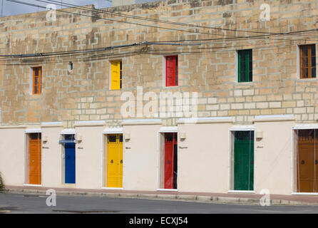 Brightly colored doors in the Fishing Village of Marsaxlokk a traditional village in Malta - Stock Photo