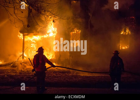 Detroit, Michigan USA - Firefighters battle a fire which destroyed a vacant home in Detroit's Morningside neighborhood. - Stock Photo