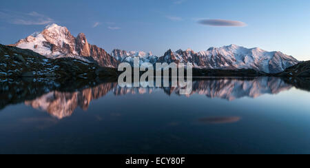 Mont Blanc massif reflected in the Lac de Chesery, left Aiguilles de Chamonix, Mont Blanc right, Chamonix, France - Stock Photo