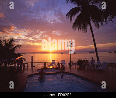 Swimming pool at sunset, Couples Negril Resort, Negril Beach, Negril, Westmoreland Parish, Jamaica, Greater Antilles, - Stock Photo