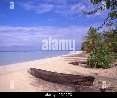 Dugout canoe on Negril Beach, Negril, Westmoreland Parish, Jamaica, Greater Antilles, Caribbean - Stock Photo