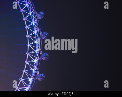 United Kingdom, England, London, Cropped view of London Eye against clear night sky - Stock Photo