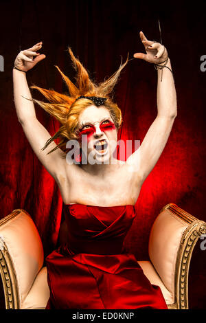 Fantasy makeover photography - Seven Deadly Sins - Wrath : A young woman girl model with spiky punky hair made up - Stock Photo