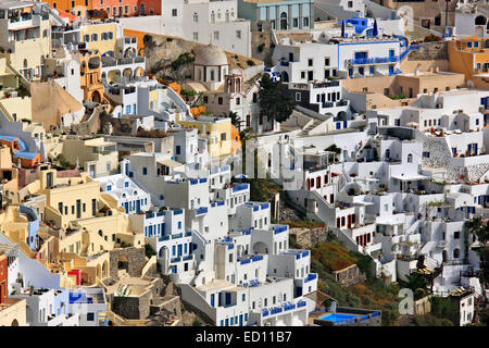 Partial view of Fira village, the 'capital' of Santorini island, hanging over the caldera. Cyclades, Greece - Stock Photo