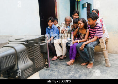 indian rural farmer family watching Television - Stock Photo