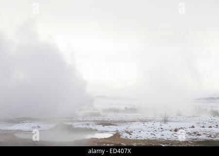 Steam rising from the ground at Haukadalur geothermal area, Iceland - Stock Photo