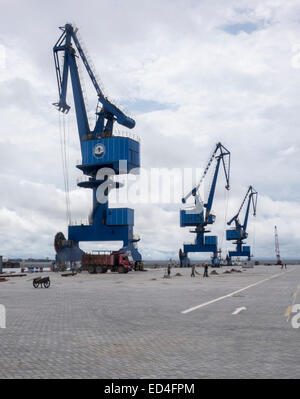 Large cranes at the new port expansion in Bata, Equatorial Guinea - Stock Photo