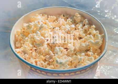 popcorn in a large glass on the table - Stock Photo