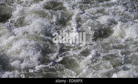 spindrift behind ship on northe sea - Stock Photo
