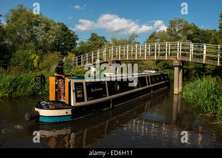Canal barge passes under footbridge, Southcote Lock, Kennet and Avon Canal near Reading, UK - Stock Photo
