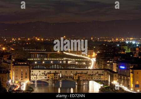 Ponte Vecchio (Old Bridge) in Florence Firenze over Arno River, Italy at night - Stock Photo