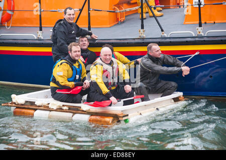Poole, Dorset, UK. 1st January, 2015. A variety of unusual craft take to the water to race from the steps of The - Stock Photo