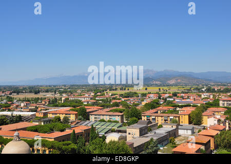 view of the Appenine mountain range from the top of the Leaning Power of Pisa - Stock Photo