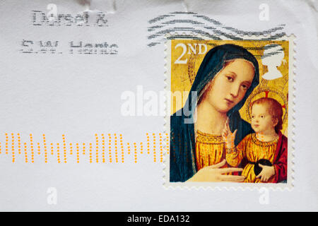 2nd class Christmas stamp with Madonna and child stuck on envelope - Stock Photo