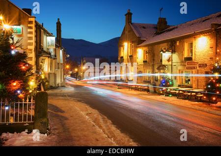 UK,Derbyshire,Peak District,Castleton,Christmas Lights with Mam Tor in Distance - Stock Photo