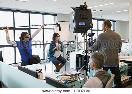 Business people filming in-house tutorial video - Stock Photo