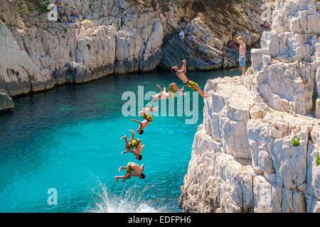 Miltiple exposure composite image of man doing a backflip from a rocky outcrop at Calanque de Sugiton - Stock Photo