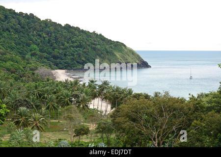 Koh Lanta Yai, View of Bamboo bay beach, Rainforest behind. Ko Lanta Yai, Thailand, Southeast Asia. - Stock Photo