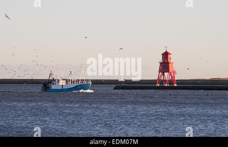 FIshing trawler 'Northern Dawn' passing the Groyne Lighthouse returning to the river Tyne, South Shields, north - Stock Photo