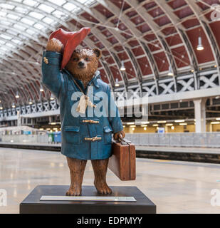 Paddington Bear statue designed by author Michael Bond at Paddington Statue to be auctioned for the NSPCC charity - Stock Photo