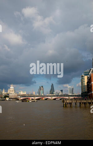 View of the city & the Thames with rain clouds - Stock Photo