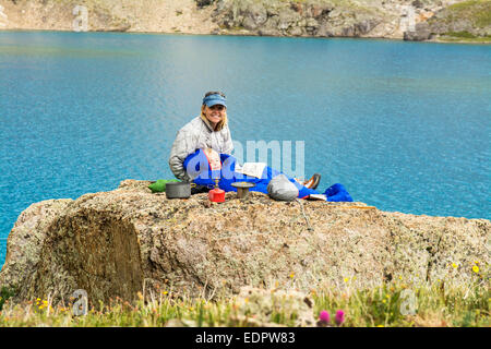 A woman and her daughter camping near blue lake, San Juan National Forest,  Silverton, Colorado. - Stock Photo
