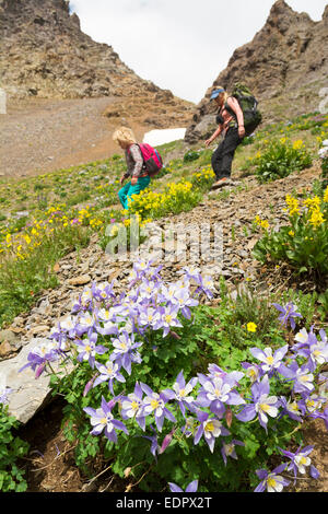 A woman and her daughter hiking down a rocky slope,   San Juan National Forest,  Silverton, Colorado. - Stock Photo