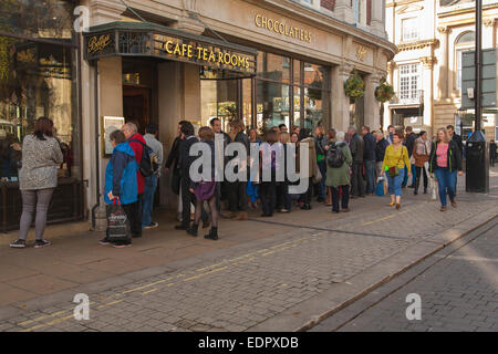 Line of people waiting to enter bettys cafe tearooms Davygate and St Helen's Square york England - Stock Photo