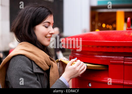 young woman posting letters - Stock Photo
