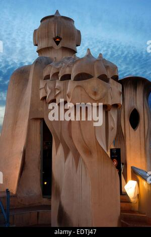 Casa Mila, La Pedrera, skyline of Barcelona, Spain. The chimneys. Panorama of the roof at dusk, evening, night. - Stock Photo