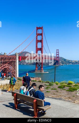 Tourists in front of the Golden Gate Bridge near the Golden Gate Bridge Pavilion, Presidio park, San Francisco, - Stock Photo