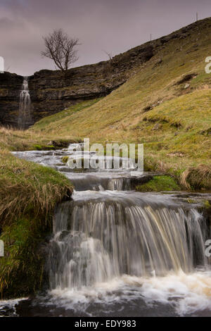 Water tumbles & cascades over rocky steps after plunging over a high cliff at Cray Gill Waterfalls - near Cray, - Stock Photo