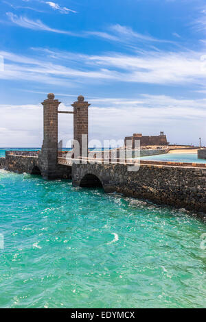 Bridge Puente de las Bolas, stone gate in front of the fort Castillo de San Gabriel, Arrecife, Lanzarote, Canary - Stock Photo