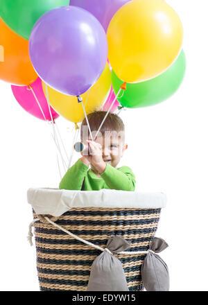 child boy on hot air balloon isolated - Stock Photo