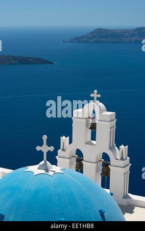 A blue domed Greek Orthodox church overlooking the sea in Firostefani, Santorini, The Cyclades, The Aegean, Greek - Stock Photo