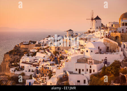 Windmill and traditional houses at sunset, Oia, Santorini (Thira), Cyclades Islands, Greek Islands, Greece, Europe - Stock Photo