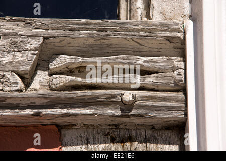UK England, Suffolk, Lavenham, Barn Street, Old Grammar School, carved  bare bottom & legs - Stock Photo