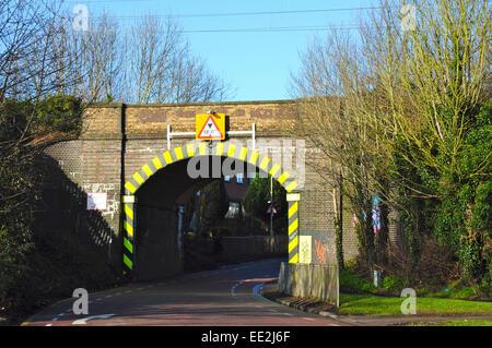 Rail over narrow road bridge, Woolgrove Road, Walsworth, Hitchin, Hertfordshire, England, UK - Stock Photo