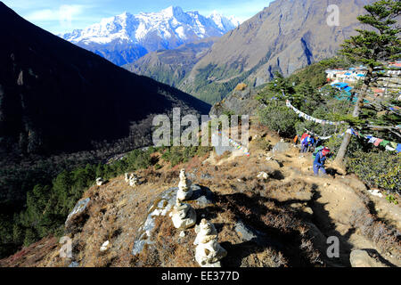 Prayer Stones and Buddhist Stupa on Tengboche Ri Hill, Tengboche village, Everest Base Camp trek, UNESCO World Heritage - Stock Photo