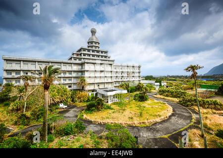 Abandoned hotel building ruins on Hachijojima Island, Japan. - Stock Photo