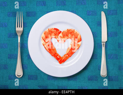 fried shrimps that looks like heart on the white plate - Stock Photo
