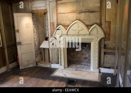 UK, London, Twickenham, Strawberry Hill House, restoratio in progress, original panelling and finished fireplace - Stock Photo