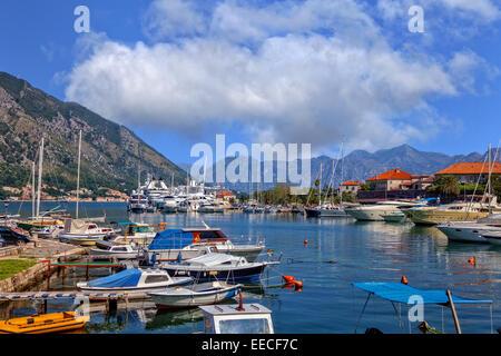 Kotor bay (Boka Kotorska) with pier and boats in Kotor, Montenegro. - Stock Photo
